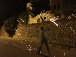 Naji's friend using steel wool to create a whirlwind of night on one of the nights leading to Ashoura (a mulsim holiday)